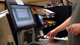 Man taking receipt after paying for food at self checkout counter stock video footage