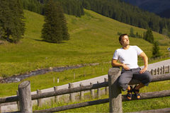 Man taking a rest from hiking Royalty Free Stock Photos
