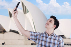 Man taking self picture near Opera House Royalty Free Stock Image