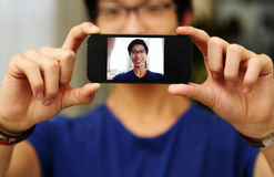 Man taking self picture with smartphone Stock Photo