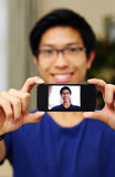 Man taking self picture with smartphone Stock Photos