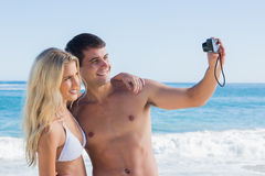 Man taking self portrait of him and girlfriend Royalty Free Stock Images