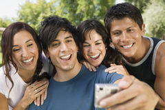 Man Taking A Self Portrait With His Friends Stock Photos