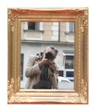 Man taking self portrait. In the mirror Stock Image