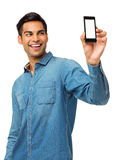 Man Taking Self Portrait Photography Through Smart Phone. Happy young man taking self portrait photography through smart phone over white background. Vertical Stock Photography