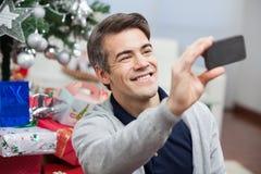 Man Taking Self Portrait Through Smartphone Stock Images