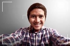 Man taking selfie. On camera Stock Photo