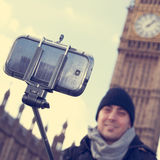 Man taking a selfie in front of the Big Ben in London, United Ki Stock Photography
