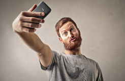 Man taking a selfie royalty free stock photography