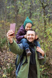 Man taking a selfie with his daughter Royalty Free Stock Image