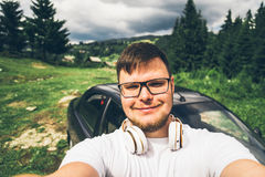 Man taking selfie on his phone in mountains Royalty Free Stock Photos