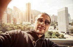 Man taking selfie in hong kong Stock Photography