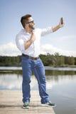Man taking selfie Stock Image