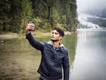 Man taking selfie at lake Royalty Free Stock Photos