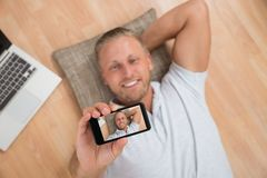 Man Taking Selfie With Mobile Phone Stock Photos