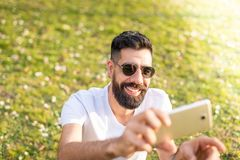 Man Taking a Selfie Outdoors stock image