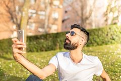Man Taking a Selfie Outdoors royalty free stock photo