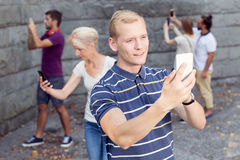 Man taking selfie with phone Stock Photography