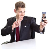 Man taking selfie photo on mobile phone Royalty Free Stock Photo