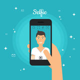 Man Taking Selfie Photo on Smart Phone. Self portrait picture  Royalty Free Stock Photo