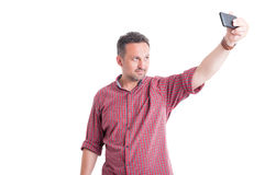 Man taking a selfie or selfportrait Stock Photography