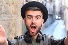 Man taking a selfie showing surprise.  Royalty Free Stock Photos