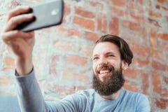 Man selfie social trend idle leisure vanity photo. Man taking a selfie and social trends. mobile photography. idle leisure and vanity stock images