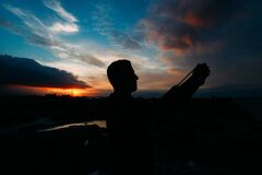 Man taking selfie at sunset Stock Photos