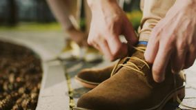 Man taking shoes off stock footage