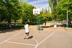 Man Taking Shot on Basket on Basketball Court Stock Images