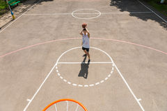 Man Taking Shot on Net on Outdoor Basketball Court Stock Photos