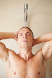 Man Taking A Shower In Bathroom. Front View Of Man Taking A Shower In Bathroom Stock Photos