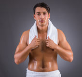 The man after taking shower on dark background Royalty Free Stock Image
