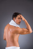The man after taking shower on dark background Royalty Free Stock Photography