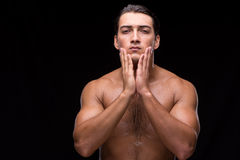 The man after taking shower on dark background Stock Images