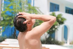 Man taking a shower in the park. happy and relaxed. Man taking a shower in the park. happy and relaxed Royalty Free Stock Photos