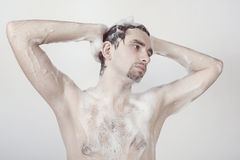 Man taking shower Stock Images
