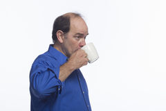 Man taking a sip from coffee mug, horizontal Royalty Free Stock Photos