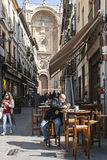 Man taking a snack on the street Marques with the facade of the Stock Photo