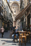 Man taking a snack on the street Marques with the facade of the Stock Images