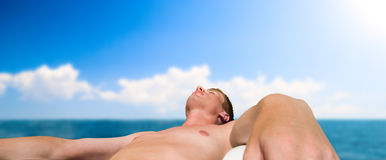 Man taking sunbathe Royalty Free Stock Images