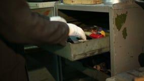 Man taking tools from metal cupboard stock footage