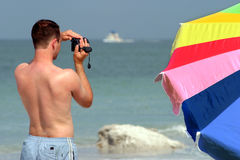Man is taking a video. Of the ocean Stock Photography