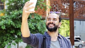 Man taking video or selfie by smartphone in city 41 stock footage