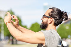 Man taking video or selfie by smartphone in city Royalty Free Stock Photos