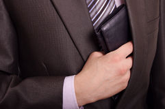Man taking wallet. Man taking out his black leather wallet from inside pocket Stock Photo