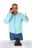 Man while talking with bakelite telephone. Stock Photos