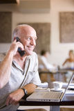 Man talking on cell phone in cafe Royalty Free Stock Image