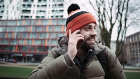 Man talking on cell phone outdoors. The bearded man. Man talking on cell phone outdoors. The bearded man stock footage