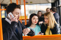 Man Talking on Cell Phone, public transportation Stock Image